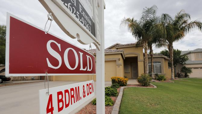 In this Monday, Aug. 26, 2013 photo, a used home is listed as sold, in Gilbert, Ariz. Freddie Mac reports on mortgage rates for this week Thursday Oct. 17, 2013. (AP Photo/Matt York)