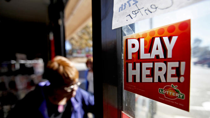 A sign on a doorway advertises the Georgia Lottery as a customer enters a convenience store, Monday, Nov. 26, 2012, in Atlanta. As the Powerball jackpot soars, a Georgia Lottery official says the agency is working to get its equipment operational again after some machines have been down. Georgia Lottery spokeswoman Kimberly Starks confirmed that some machines were not working properly. She said Monday afternoon that lottery officials are aware of the situation, and are working to correct the problems. (AP Photo/David Goldman)