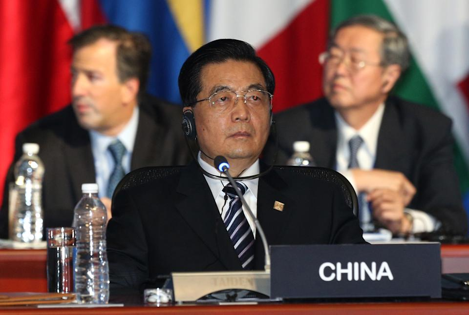 China's President Hu Jintao listens the opening speech by Mexico's President Felipe Calderon during the first plenary session of the G-20 Summit in Los Cabos, Mexico, Monday, June 18, 2012. (AP Photo/Andres Leighton)