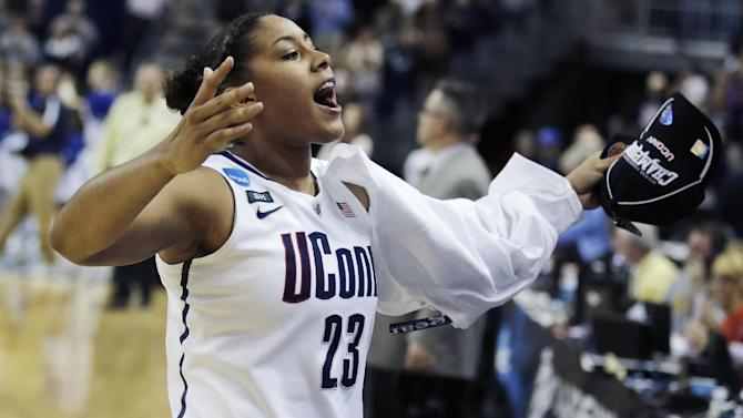 Connecticut forward Kaleena Mosqueda-Lewis celebrates after beating Kentucky in the women's NCAA regional final basketball game in Bridgeport, Conn., Monday, April 1, 2013. Mosqueda-Lewis scored 17 points in the Connecticut 83-53 win advancing them to the Final Four. (AP Photo/Charles Krupa)