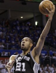 San Antonio Spurs center Tim Duncan shoots against the Oklahoma City Thunder during the first half of Game 4 in the NBA basketball playoffs Western Conference finals, Saturday, June 2, 2012, in Oklahoma City. (AP Photo/Eric Gay)