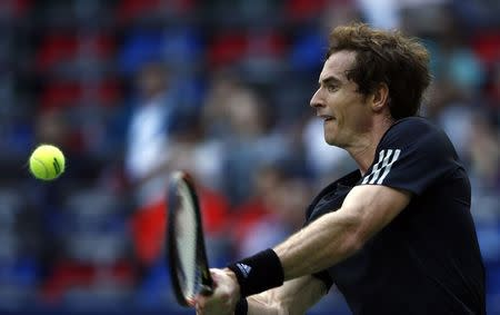 Andy Murray of Britain returns a shot during his men's singles tennis match against David Ferrer of Spain at the Shanghai Masters tennis tournament in Shanghai