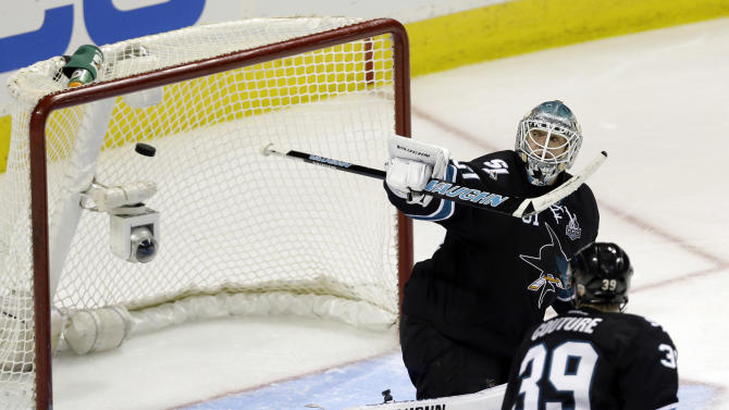 A shot from Vancouver Canucks defenseman Alexander Edler gets past San Jose Sharks goalie Antti Niemi, of Finland, for a goal during the third period of Game 4 of their first-round NHL hockey Stanley Cup playoff series in San Jose, Calif., Tuesday, May 7, 2013. (AP Photo/Marcio Jose Sanchez)