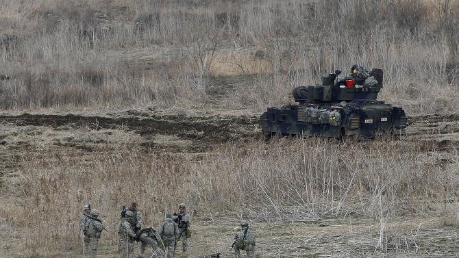 U.S. Army soldiers conduct their annual military drills in Yeoncheon, South Korea, near the border with North Korea, Tuesday, April 9, 2013. North Korea on Tuesday urged all foreign companies and tourists in South Korea to evacuate, saying the two countries are on the verge of a nuclear war. The new threat appeared to be an attempt to scare foreigners into pressing their governments to pressure Washington and Seoul to act to avert a conflict.(AP Photo/Ahn Young-joon)