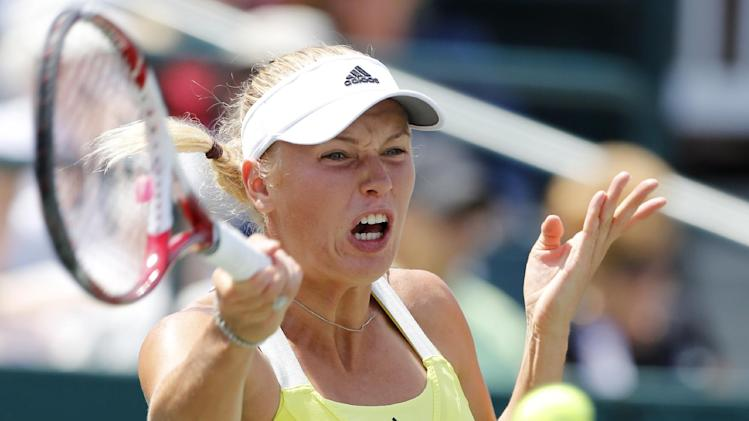 Caroline Wozniacki, of Denmark, returns to Silvia Soler-Espinosa, of Spain, at the Family Circle Cup tennis tournament in Charleston, S.C., Wednesday, April 3, 2013.  (AP Photo/Mic Smith)