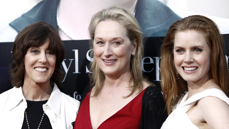 "FILE - This July 27, 2009 file photo shows director and writer Nora Ephron, left, and cast members Meryl Streep, center, and Amy Adams pose together at the premiere of ""Julie and Julia"" in Los Angeles. Publisher Alfred A. Knopf confirmed Tuesday, June 26, 2012, that author and filmmaker Nora Ephron died Tuesday of leukemia in New York. She was 71. (AP Photo/Matt Sayles, file)"