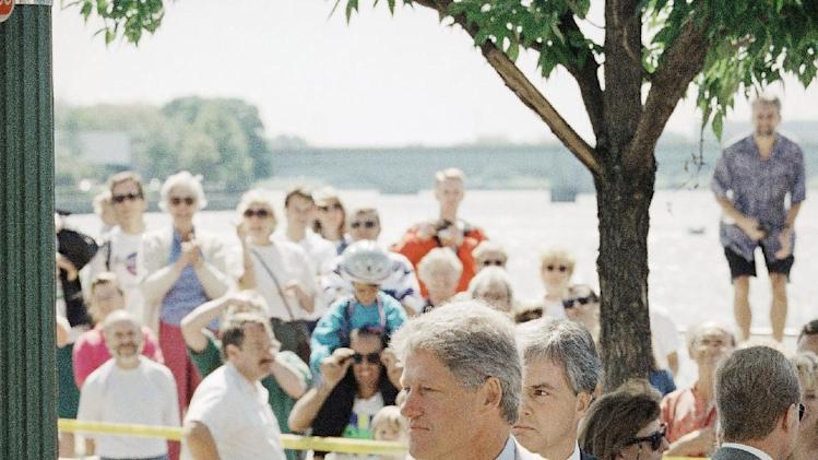 FILE-In this Sept. 12, 1993 file photo, President Bill Clinton stands outside a Georgetown restaurant near the Potomac River in Washington. President Barack Obama's summer fashion choice, not unprecedented among presidents - himself included - was the talk of social media, Thursday, Aug. 28, 2014. Other presidents who have taken on tan include Clinton, Ronald Reagan, George H. W. Bush, George W. Bush and Dwight Eisenhower. (AP Photo/J. Scott Applewhite, file)