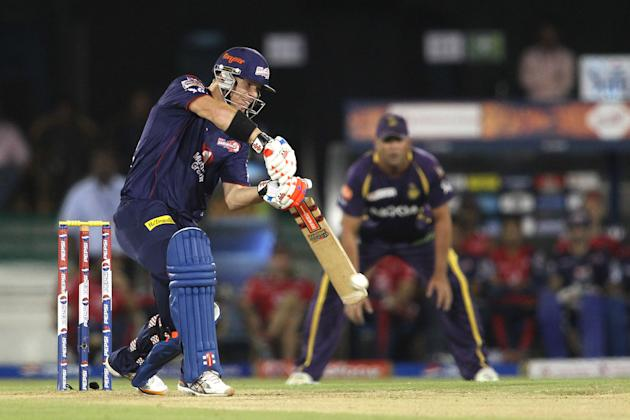 David Warner of Delhi Daredevils drives a delivery through to the boundary during match 44 of the Pepsi Indian Premier League between The Delhi Daredevils and the Kolkata Knight Riders held at the Chh