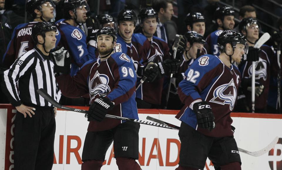 Colorado Avalanche center Ryan O'Reilly (90) is congratulated by teammates after scoring a goal against the Chicago Blackhawks in the second period of an NHL hockey game in Denver, Friday, March 8, 2013. Avalanche left wing Gabriel Landeskog, right, of Sweden, heads back to the ice. (AP Photo/David Zalubowski)