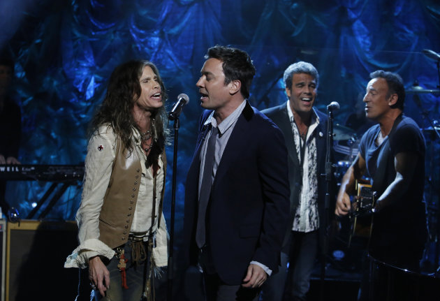 In this photo provided by NBC, from left, Steven Tyler, Jimmy Fallon, Mark Rivera, and Bruce Springsteen, perform during &quot;Hurricane Sandy: Coming Together&quot; Friday, Nov. 2, 2012, in New York. Hosted by Matt Lauer, the event is heavy on stars identified with New Jersey and the New York metropolitan area, which took the brunt of this week&#39;s deadly storm. (AP Photo/NBC, Heidi Gutman)