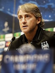 Manchester City coach Roberto Mancini speaks during a press conference in Amsterdam on the eve of the UEFA Champions League football match against Ajax. City will be out to show they have learned from last season&#39;s mistakes when the English Premier League titleholders travel to Amsterdam