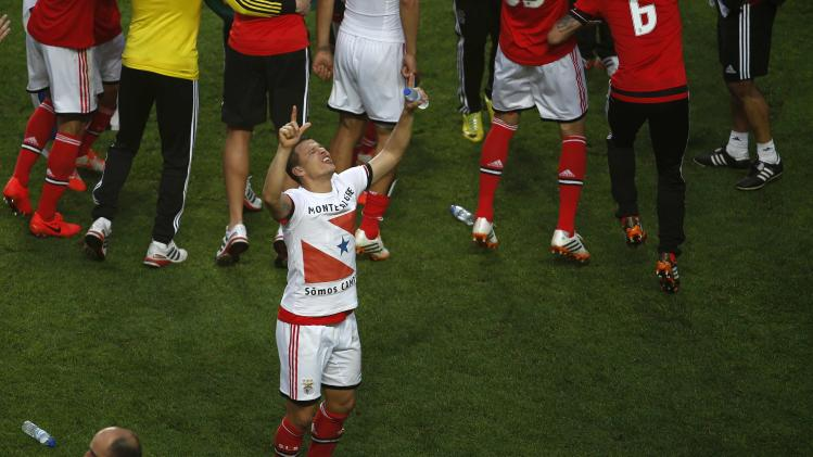 Benfica's Rodrigo Lima celebrates winning the Portuguese Premier League title after beating Olhanense at Luz stadium in Lisbon