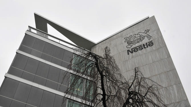FILE - In this Feb. 19, 2010 file photo, an exterior view of the Nestle headquarters in Vevey, Switzerland. The world's biggest food and drinks maker Nestle SA has become the latest company to pull some of its products off European shelves after they were found to contain undeclared horse meat. The company, based in Vevey, Switzerland, said in a statement late Monday, Feb. 18, 2013 that it withdrew some of its beef pasta ready meals from sale after tests conducted two days earlier detected horse DNA. (AP Photo/Keystone, Dominic Favre, File)