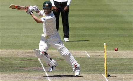 Australia's Warner plays a shot on the first day of their third test cricket match against South Africa in Cape Town