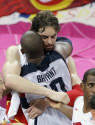 United States' Kobe Bryant hugs Spain's Pau Gasol following the men's gold medal basketball game at the 2012 Summer Olympics, Sunday, Aug. 12, 2012, in London. (AP Photo/Matt Slocum)