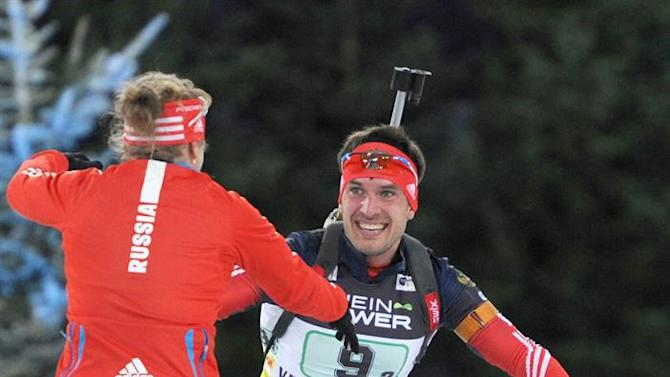 DUS334. Gelsenkirchen (Germany), 27/12/2014.- Russians Jana Romanova (L) and Evgeni Garanitschev celebrate after finishing in third place in the 13th Biathlon-World-Team-Challenge (WTC) in the Veltins-Arena Gelsenkirchen, Germany, 27 December 2014. Ten mixed teams from various nations compete at the WTC in the Arena. The winning team is determined after a mass start race and a pursuit competition. (Alemania) EFE/EPA/Caroline Seidel