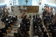 <p>Syrians attend Christmas eve mass at the Mar Elias (St. Elijah) Christian Orthodox church in Bab Tuma, a predominantly Christian quarter of Damascus, on December 24, 2012. With ongoing fighting between Syrian government troops and rebel forces in areas of the Syrian capital, Christians in this diocese are attending church early.</p>