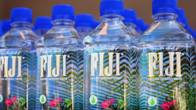 FILE-This May 1, 2010 file photo released by Fiji Water shows FIJI Water bottles in Los Angeles. With a net worth of $2.2 billion, Lynda and Stewart Resnick, owners of POM Wonderful, Fiji Water, the flower delivery service Teleflora and some of the nation's largest nut and citrus farms are ranked No. 218 in Forbes' 2012 400 list. (AP Photo/Fiji Water, Shea Walsh, file)
