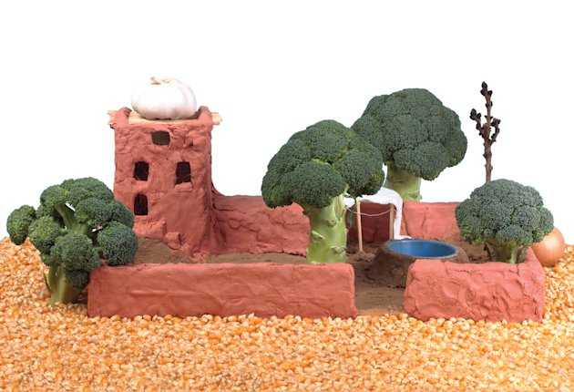clay house with broccoli trees
