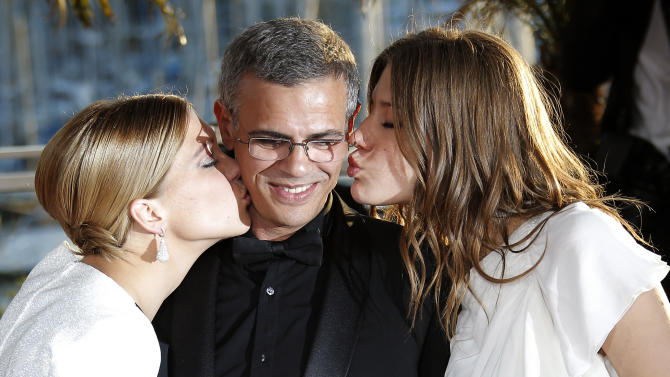 Actress Lea Seydoux, left, director Abdellatif Kechiche, centre, and Adele Exarchopoulos pose with the Palme d'Or award for the film La Vie D'Adele during a photo call after an awards ceremony at the 66th international film festival, in Cannes, southern France, Sunday, May 26, 2013. (AP Photo/Lionel Cironneau)