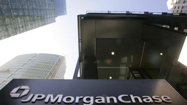 Rising legal costs push JPMorgan to rare loss
