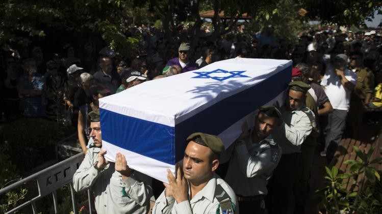 Israeli soldiers carry the flag-draped coffin of fallen reserve Israeli soldier Yair Ashkenazy during his funeral in Rehovot, near Tel Aviv