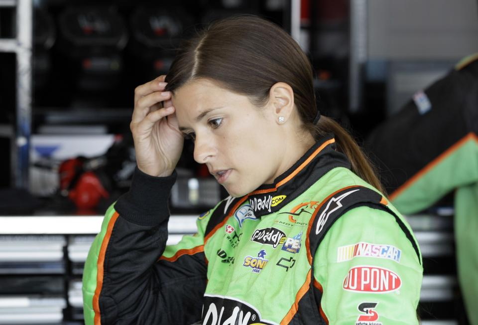 Danica Patrick checks her hair during practice for Sunday's NASCAR Nationwide Series auto race at Chicagoland Speedway in Joliet, Ill., Saturday, July 21, 2012. (AP Photo/Nam Y. Huh)