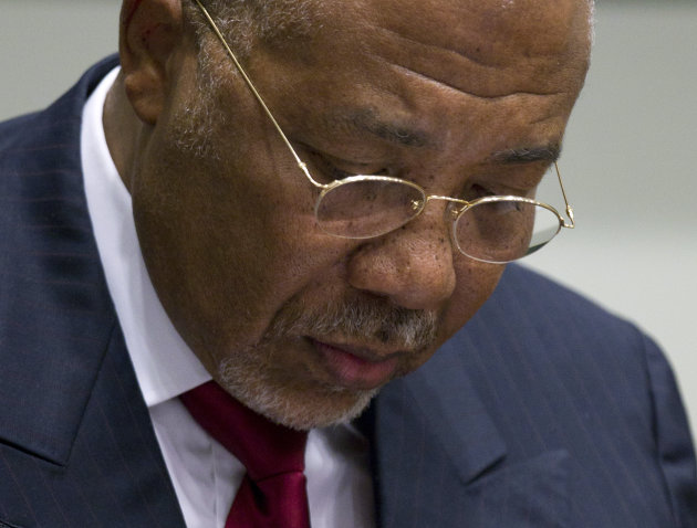 Former Liberian President Charles Taylor looks down as he waits for the start of a hearing to deliver verdict in the court room of the Special Court for Sierra Leone in Leidschendam, near The Hague, N