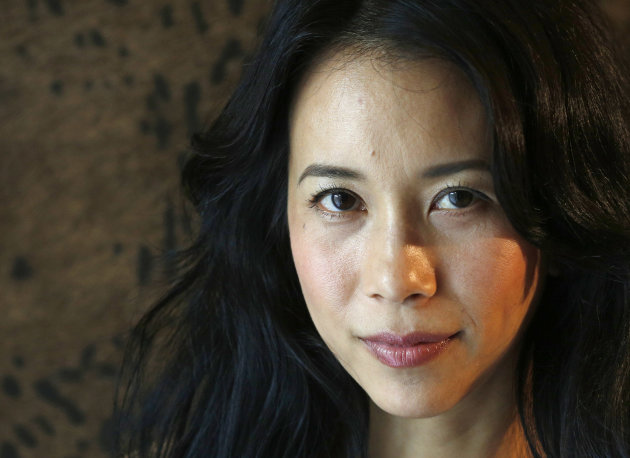 "Hong Kong actress Karen Mok poses during an interview with the Associated Press at a hotel in Hong Kong Thursday, Jan. 31, 2013. Karen Mok is releasing a jazz album and filming Keanu Reeves's directorial debut ""Man of Tai Chi."" (AP Photo/Vincent Yu)"