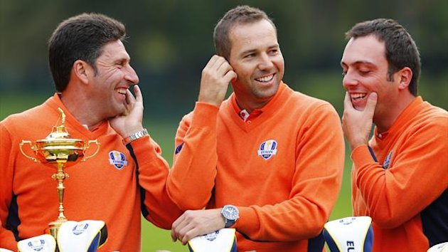 European team captain Jose Maria Olazabal (L) talks with Sergio Garcia and Francesco Molinari during a team photo at the 39th Ryder Cup golf matches at the Medinah Country Club in Medinah, Illinois, September 25, 2012.
