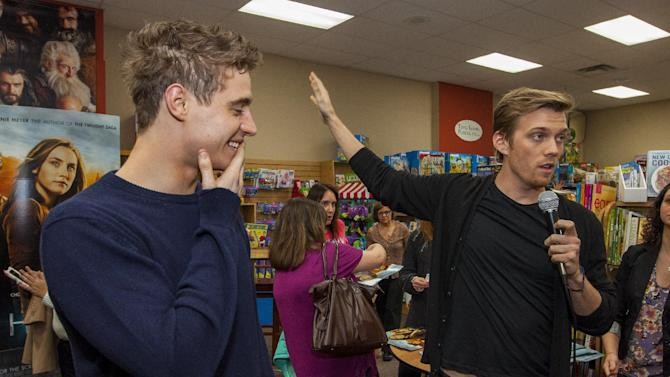 "Actor Max Irons and actor Jake Abel during ""The Host"" book signing at the Anderson's Bookshop on Monday, March 11, 2013, in Chicago. (Photo by Barry Brecheisen/Invision/AP)"