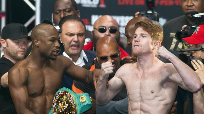 Undefeated boxers Mayweather Jr. of the U.S. and Alvarez of Mexico pose during an official weigh-in at the MGM Grand Garden Arena in Las Vegas