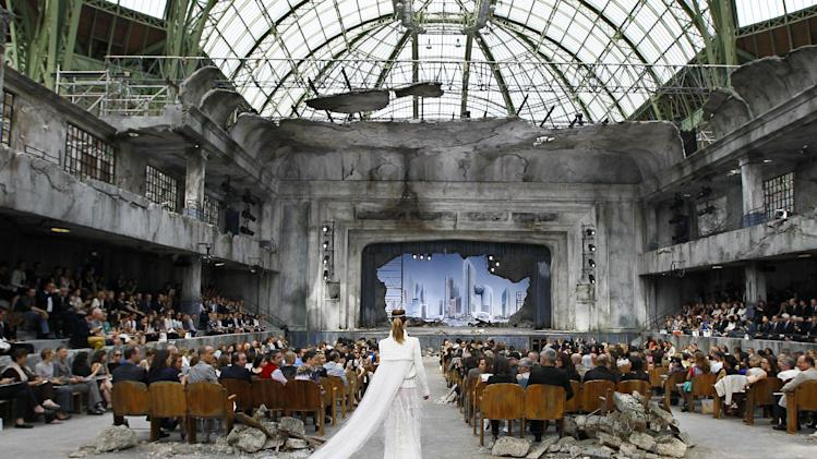 A model wears a creation by German fashion designer Karl Lagerfeld for Chanel's Haute Couture Fall-Winter 2013-2014 collection, presented Tuesday, July 2, 2013 in Paris. (AP Photo/Francois Mori)