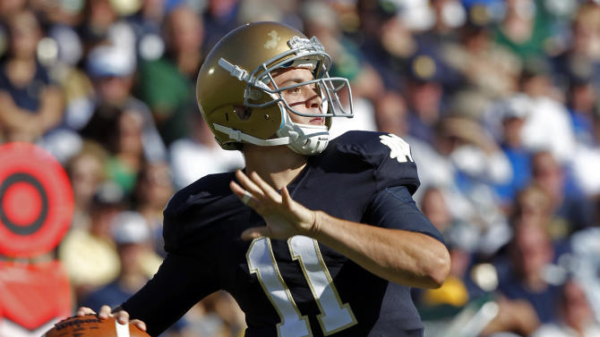 Notre Dame quarterback Tommy Rees throws against Michigan State during the first half of an NCAA college football game in South Bend, Ind., Saturday, Sept. 17, 2011. (AP Photo/Michael Conroy)
