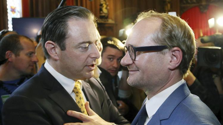 N-VA President De Wever and party member Weyts attend celebrations marking the Flemish Community Day at Brussels' town hall