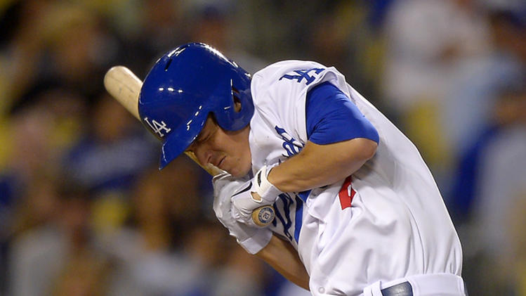Los Angeles Dodgers' Zack Greinke winces after being hit with a pitch during the seventh inning of their baseball game against the Arizona Diamondbacks, Tuesday, June 11, 2013, in Los Angeles. (AP Photo/Mark J. Terrill)