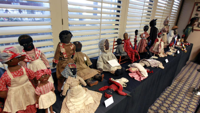In this Wednesday, July 25, 2012 photo, historic black cloth dolls appear on display in New Orleans. Amid rare antique dolls crafted in porcelain, whimsical Kewpies and homage to contemporary icon Barbie, cloth dolls in the image of African-Americans drew special attention as more than 1,200 collectors gathered in New Orleans for the annual convention of the United Federation of Doll Clubs. (AP Photo/Gerald Herbert)