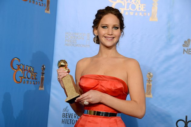 Jennifer Lawrence poses with the award for best performance by an actress in a motion picture comedy or musical for Silver Linings Playbook backstage at the 70th Annual Golden Globe Awards at the Beverly Hilton Hotel on Sunday Jan. 13, 2013, in Beverly Hills, Calif. (Photo by Jordan Strauss/Invision/AP)