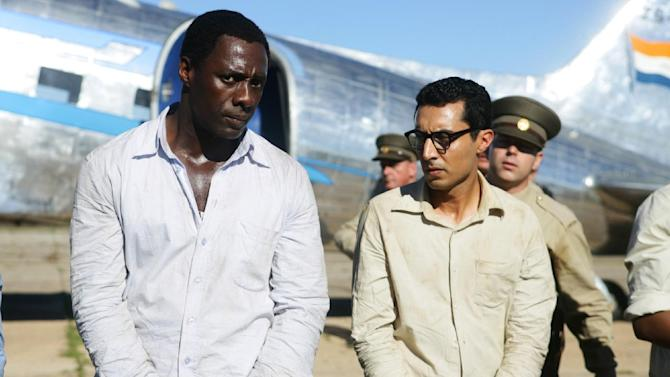 """This photo released by The Weinstein Company shows Idris Elba, left, as Nelson Mandela, and Riaad Moosa, as Ahmed Kathrada, in the film, """"Mandela: Long Walk to Freedom."""" (AP Photo/The Weinstein Company, Keith Bernstein)"""
