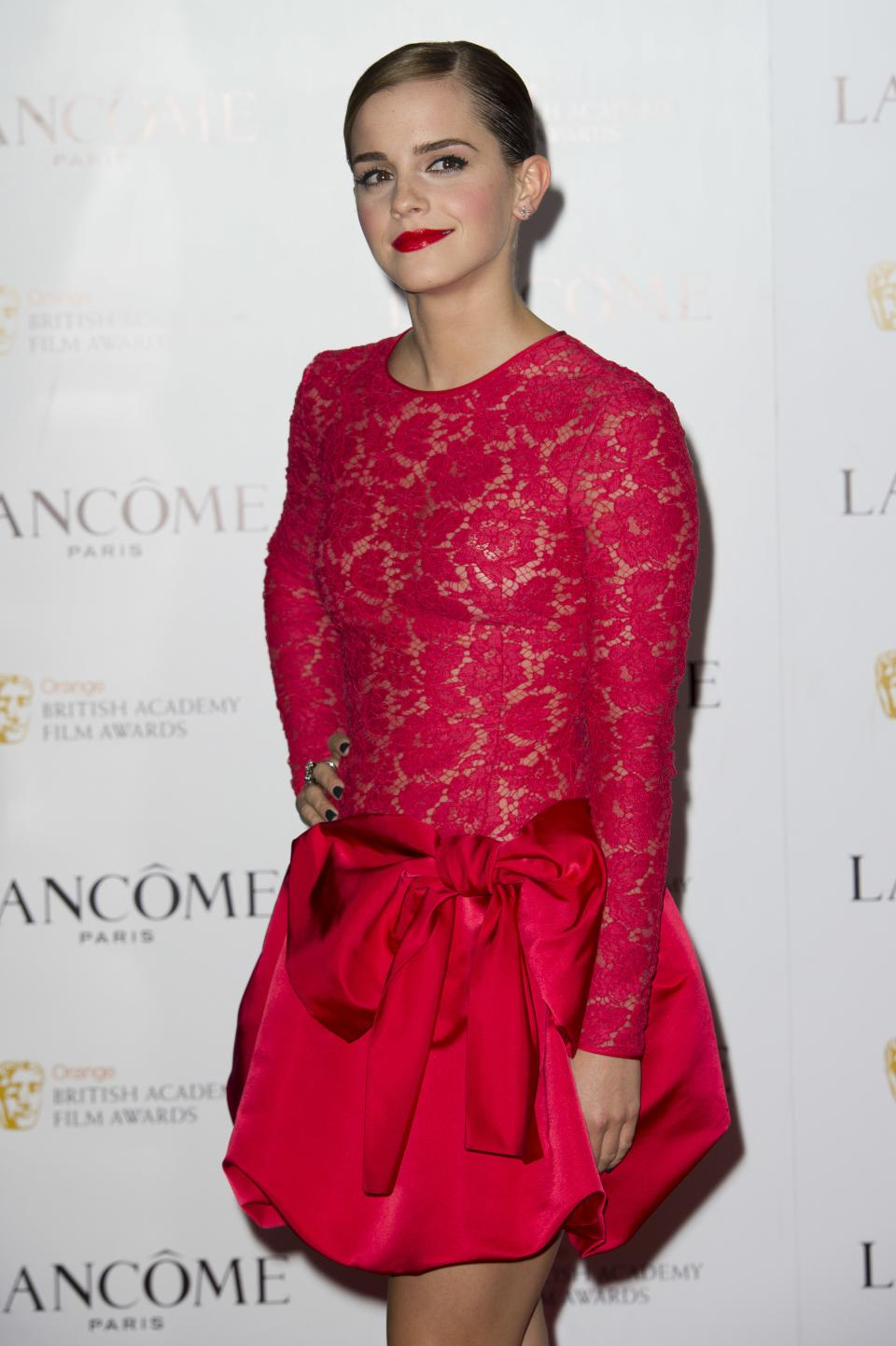 British actress Emma Watson, arrives for the Lancome pre-BAFTA cocktail party at a central London venue, Friday, Feb. 10, 2012. (AP Photo/Jonathan Short)