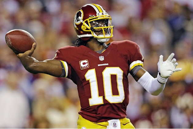 Washington Redskins quarterback Robert Griffin III passes the ball during the first half of an NFL football game against the New York Giants in Landover, Md., Monday, Dec. 3, 2012. (AP Photo/Patrick S