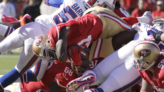 San Francisco 49ers running back Frank Gore scores on a touchdown run against the Buffalo Bills during the third quarter of an NFL football game in San Francisco, Sunday, Oct. 7, 2012. (AP Photo/Ben Margot)