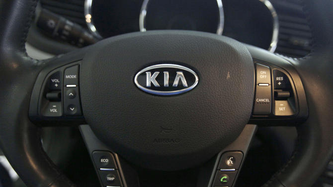 This Friday, Oct. 5, 2012, photo, shows a Kia optima's steering wheel inside of a Kia car dealership in Elmhurst, Ill.  Korean automakers Hyundai and Kia announced Wednesday, April 3, 2013, that they recalling almost 1.9 million vehicles to fix problems with air bags and brake light switches. The switch recall covers almost 1.7 million vehicles — most of the automakers' model lineups from the 2007 through 2011 model years.(AP Photo/Nam Y. Huh)