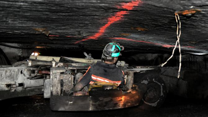 In this April 2010 photo, a coal miner drives a scoop while working in the Tech Leasing and Rebuild Inc. Mine #1 in Buchanan County, Va. Once, coal miners were literally at war with their employers. Today, their descendants are allies in a rhetorical war playing out across eastern Kentucky, southwestern Virginia and all of West Virginia. The message: They now face a common enemy - the federal government, especially the president and the Environmental Protection Agency. The war on coal is a sound bite and a headline, perpetuated by pundits, power companies and public relations consultants who have crafted a neat label for a complex set of realities, one that compels people to choose sides. (AP Photo/Bristol Herald Courier, David Crigger)