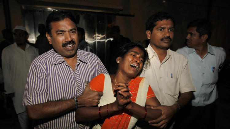 An Indian woman Sujatha, wails after seeing her husband  Venkateshwarulu's body, unseen, killed in bomb blast, at a mortuary at Government hospital  in Hyderabad, India, Thursday, Feb. 21, 2013. A pair of bombs exploded Thursday evening in a crowded shopping area in the southern Indian city of Hyderabad, killing several people and wounding many in the worst bombing in the country in more than a year, officials said. (AP Photo/Mahesh Kumar A.)