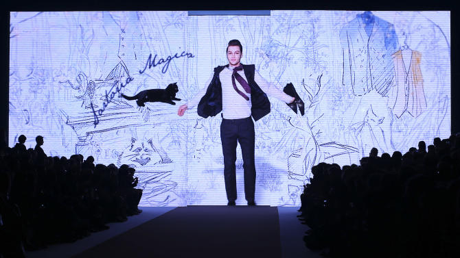 The image of a model is projected on a giant screen, during the Etro men's Fall-Winter 2014 collection, part of the Milan Fashion Week, unveiled in Milan, Italy, Monday, Jan. 13, 2014. (AP Photo/Antonio Calanni)