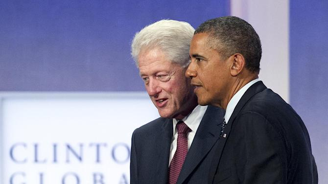 FILE - This Sept. 24, 2013 file photo shows former President Bill Clinton and President Barack Obama at the Clinton Global Initiative in New York. On its face, the annual Clinton Global Initiative meeting here provided a platform for Bill, Hillary and Chelsea Clinton to announce a series of financial commitments from corporations, non-governmental organizations and philanthropists to address intractable problems around the globe. Perhaps more than any other year, however, the New York gathering of Clinton loyalists and luminaries offered a vivid look at the past, present and future of one of America's most dominant political families. (AP Photo/Mark Lennihan, File)