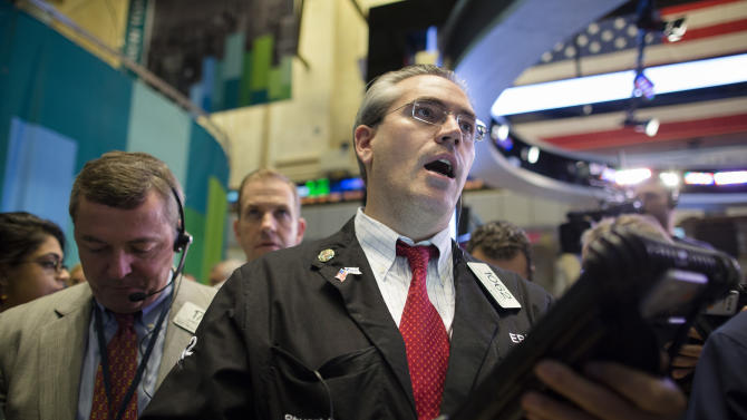 Trader Eric Schumacher works on the floor of the New York Stock Exchange, Friday, Oct. 26, 2012, in New York. (AP Photo/John Minchillo)