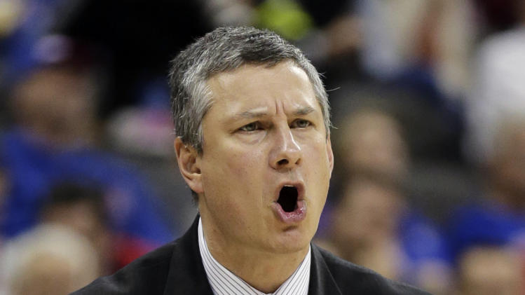 La Salle head coach John Giannini reacts to a call during the first half of a third-round game against Mississippi in the NCAA college basketball tournament, Sunday, March 24, 2013, in Kansas City, Mo. (AP Photo/Charlie Riedel)