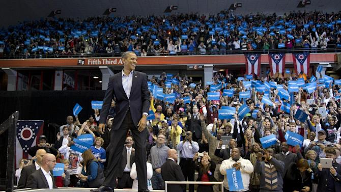President Barack Obama arrives to a cheering crowd at a campaign event at the Fifth Third Arena on the University of Cincinnati campus, Sunday, Nov. 4, 2012, in Cincinnati. (AP Photo/Carolyn Kaster)